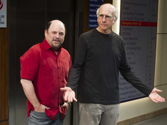 Jason Alexander, left, and Larry David pose for a photo