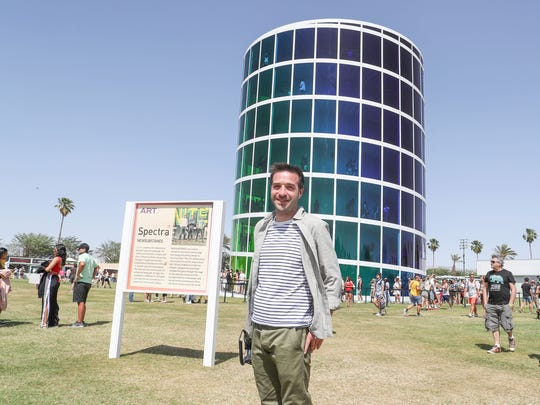 Patrick O'Mahony stands near The Spectra art installation during the Coachella Valley Music and Arts Festival at Empire Polo Club. Mandatory Credit: Jay Calderon/The Desert Sun via USA TODAY NETWORK
