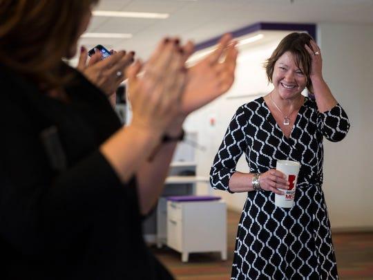 The Des Moines Register staff applauds editorial writer