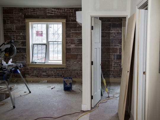 Inside one of six apartments being remodeled in the Silvers Building on fifth street in Valley Junction on Wednesday, April 18, 2018, in West Des Moines. The updated apartments will retain some of the original architectural elements including arched doorways, built-in cabinets and exposed brick walls.