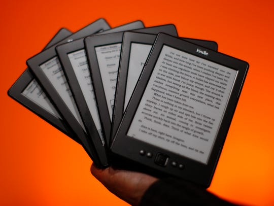 Kindle reading devices are seen at a press conference