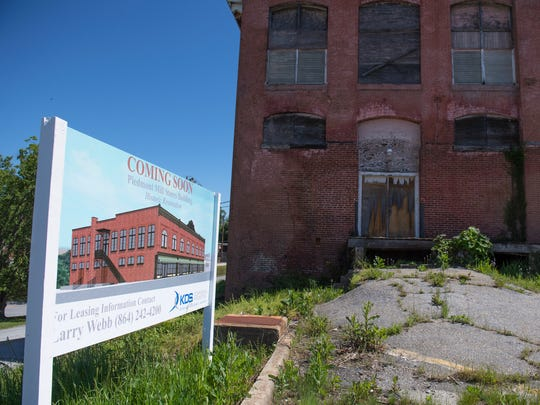A sign shows development plans in downtown Piedmont  on Monday, April 30, 2018.