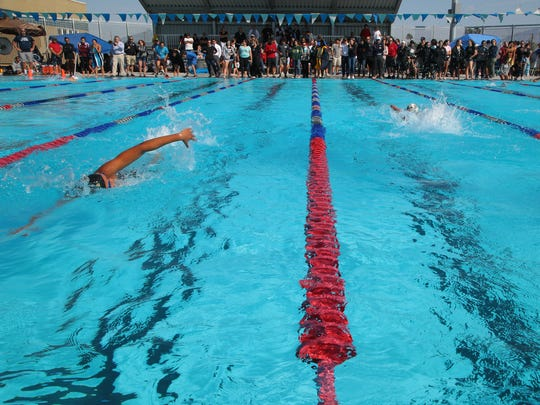 Akemi Von Scherr, right, places a big lead over Desiree Lewis in the 200 freestyle at the Desert Valley League swimming championships, Cathedral City, Calif,. May 1, 2018.
