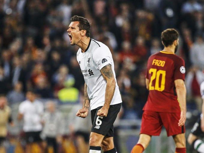 Liverpool's Dejan Lovren (L) celebrates after the UEFA