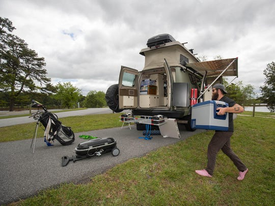 Hawley packs up his van at the Old Federal Campground