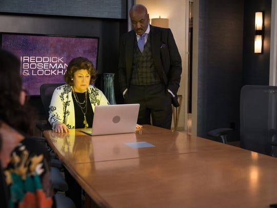 """Margo Martingale as Ruth Eastman and Delroy Lindo as Adrian Boseman watching a certain tape on """"The Good Fight."""""""