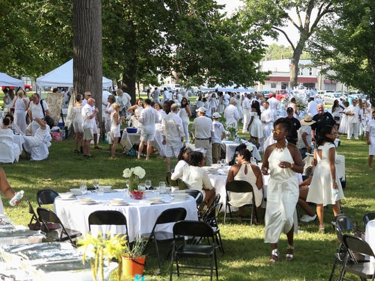 Hundreds of white-clad revelers filled Clark Park in