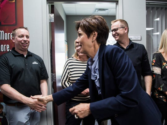 Iowa Governor Kim Reynolds hands out pens and shakes hands with employees of MobileDemand in Hiawatha after signing the tax cut bill passed by the Iowa legislature this session, on Wednesday, May 30, 2018, in eastern Iowa.