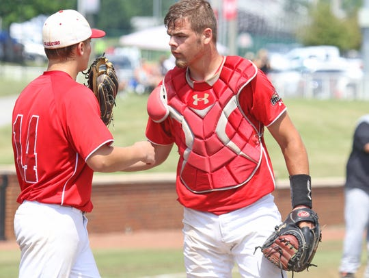 Riverheads' pitcher Elijah Dunlap consults with catcher