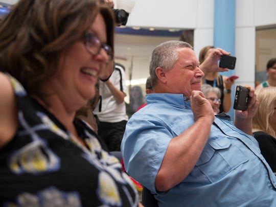 Tina and Thomas Clayton react as GHS Children's Hospital holds a graduation ceremony for their daughter, Tabitha, on Monday, June 11, 2018. Tabitha, who was born with congenital brain abnormalities and has been in the hospital for the past month, was unable to attend her graduation ceremony at McCarthy Teszler School in Spartanburg.