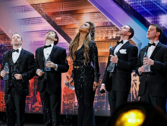 'America's Got Talent' host Tyra Banks, center, put