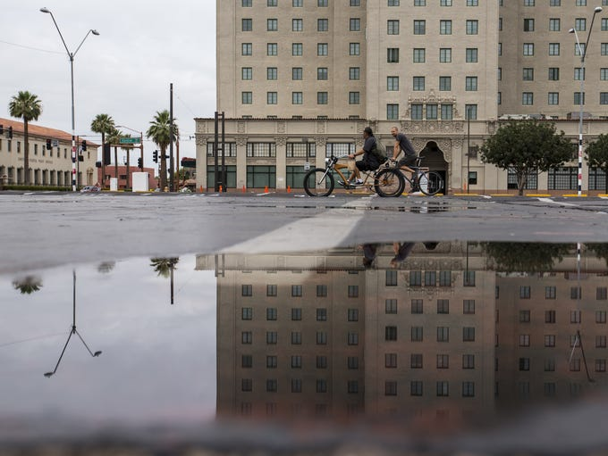 The Westward Ho is reflected in a puddle on June 16,