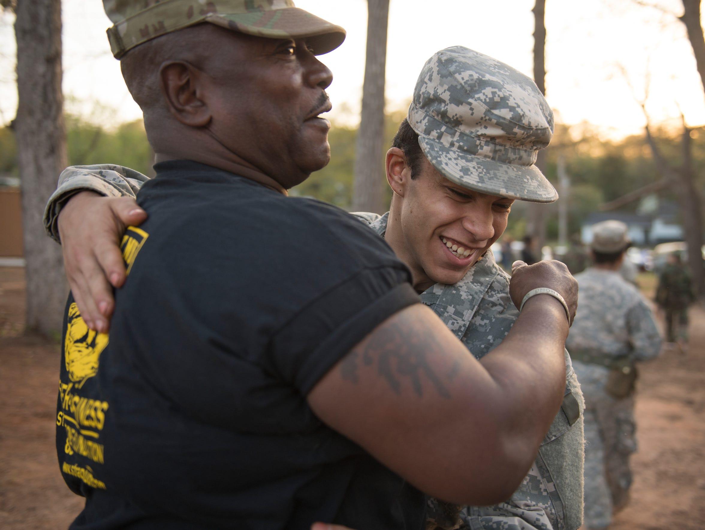 Jose Lopez, 15, hugs Drill Sergeant Steven Sullivan