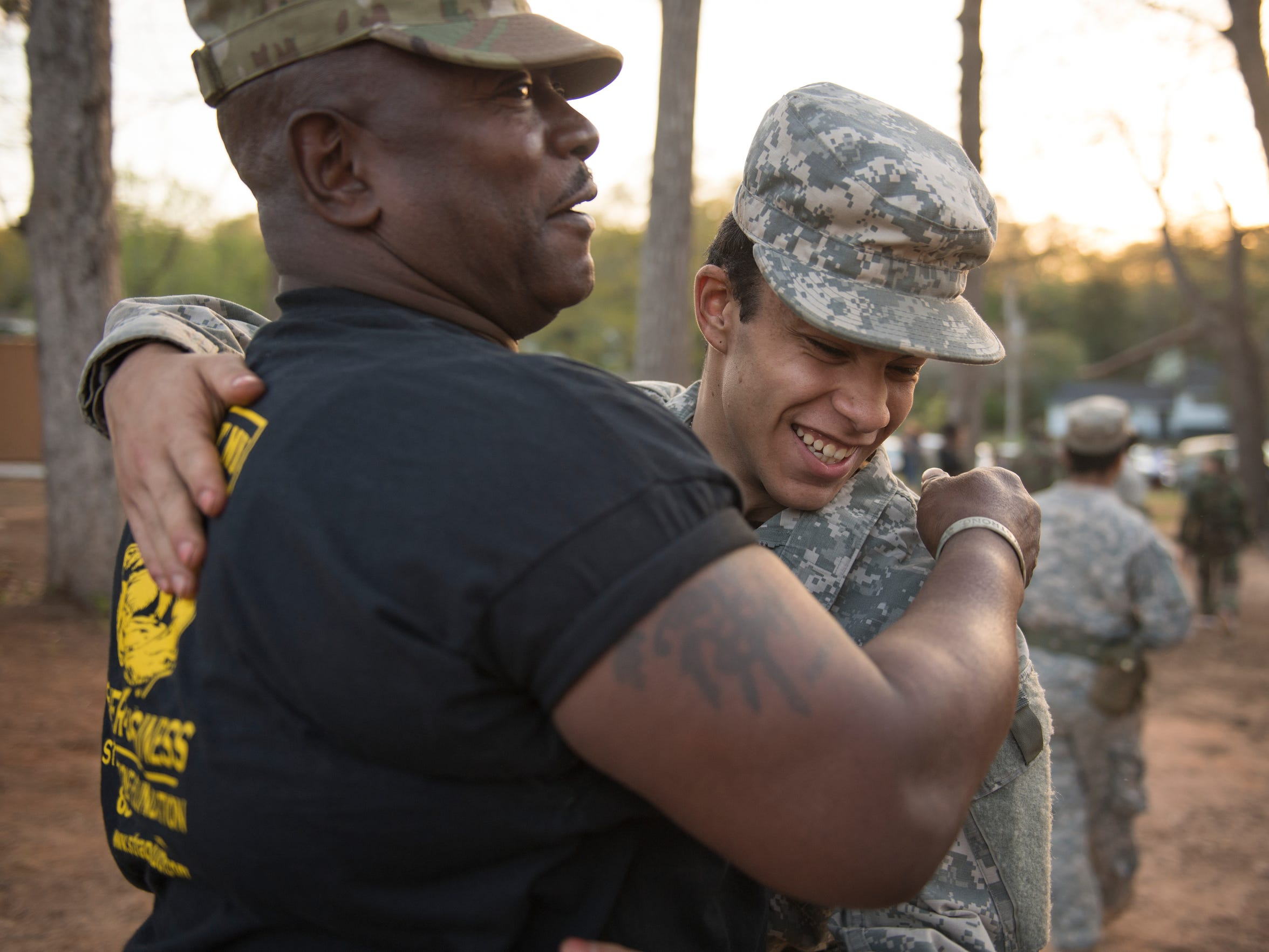 Jose Lopez, 15, hugs Drill Sergeant Steven Sullivan on Tuesday, April 10, 2018. Lopez, who has been dealing with issues at home, said he sees the drill sergeant as a big brother to him.