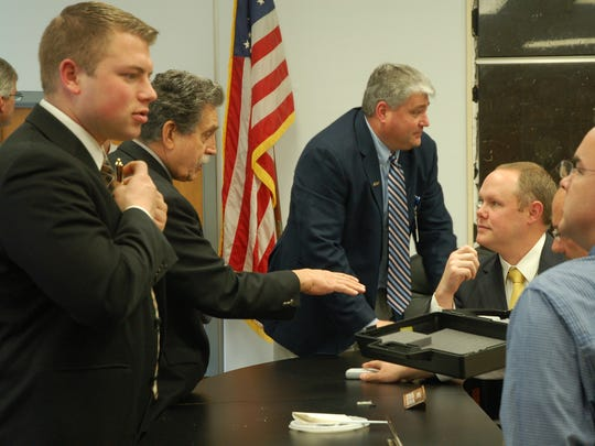 Anderson County Commissioners Zach Bates, left, Jerry Creasey and Tracy Wandell, Oliver Springs City Manager David L. Bolling and Scott Gillenwaters, talk following a meeting Tuesday, Jan. 18, 2011 at the Anderson County Courthouse in Clinton. Gillenwaters is a potential candidate for an interim seat on Anderson County School Board.