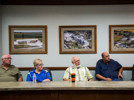 Farmers from Wright County listen to Iowa Gov. Kim Reynolds during a roundtable discussion on Chinese tariffs and the impact they are having on Iowa's agricultural production July 12 at the Gold-Eagle Cooperative in Eagle Grove.