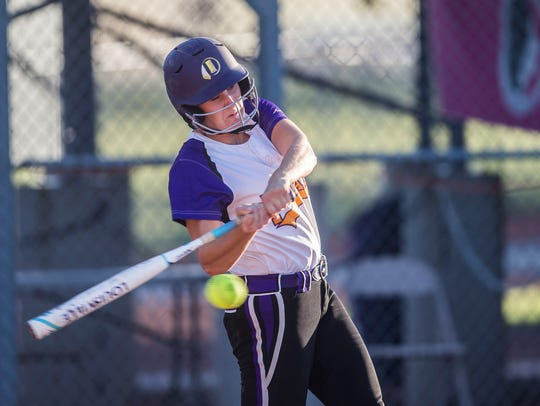 Indianola's Sydney Sickels at bat during the state