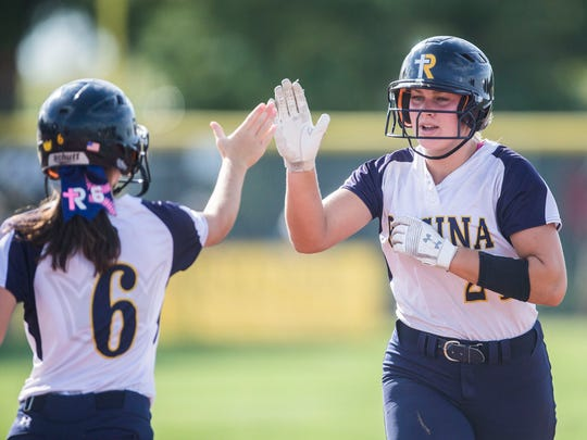 Regina's Emma Sueppel high-fives Regina's Katie Bracken during the state softball semifinal between Iowa City Regina and Des Moines Christian on Wednesday, July 18, 2018, at the Rogers Sports Complex in Fort Dodge.
