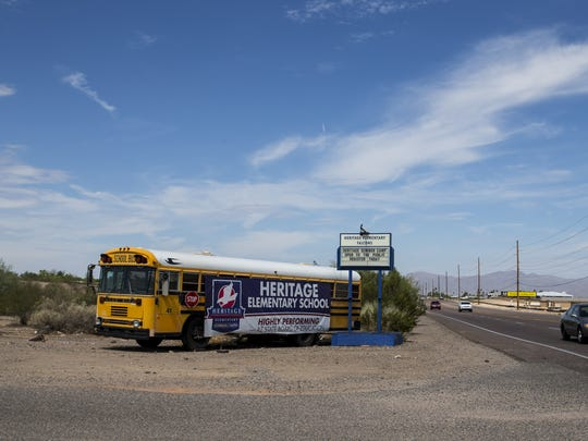 A school bus with a sign for Heritage Elementary School is pictured on July 17, 2018, in Glendale, Ariz.