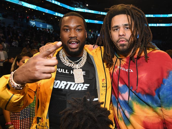 Meek Mill (L) and J. Cole attend the 68th NBA All-Star