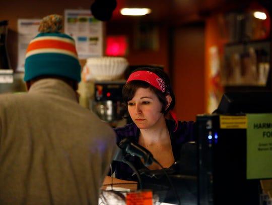 Stephanie Reinhardt waits on a customer at the Harmony