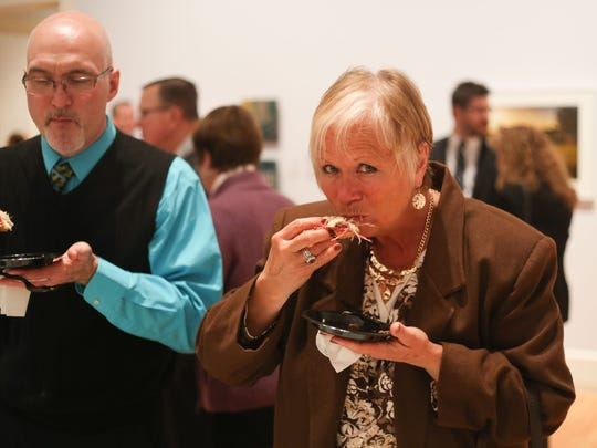 Carol Houssock of Horseheads tries the mini Reuben from Horigan's Tavern during the sixth annual Taste of Downtown event at the Arnot Art Museum on Thursday.