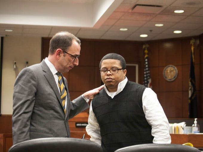 Defense Attorney Ted Shouse talks with Dejuan Hammond