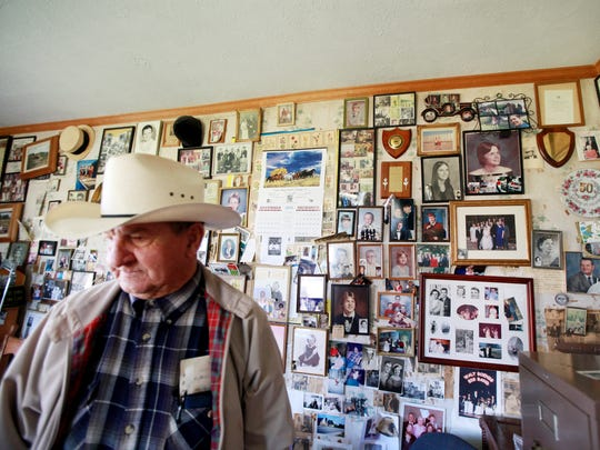 Henry Curd of Fishersville has been an auctioneer for the majority of his life. The walls of his office are plastered with photos of family and friends and mementos of past achievements.