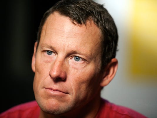 2015-02-18-lance-armstrong-careless-driving