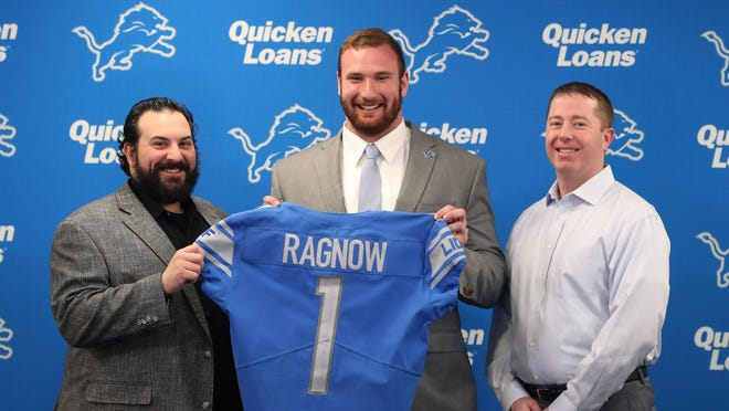 The Detroit Lions first-round NFL football draft pick Frank Ragnow, center, stands with head coach Matt Patricia, left, and general manager Bob Quinn at the team's training facility, Friday, April 27, 2018, in Allen Park, Mich. (AP Photo/Carlos Osorio)