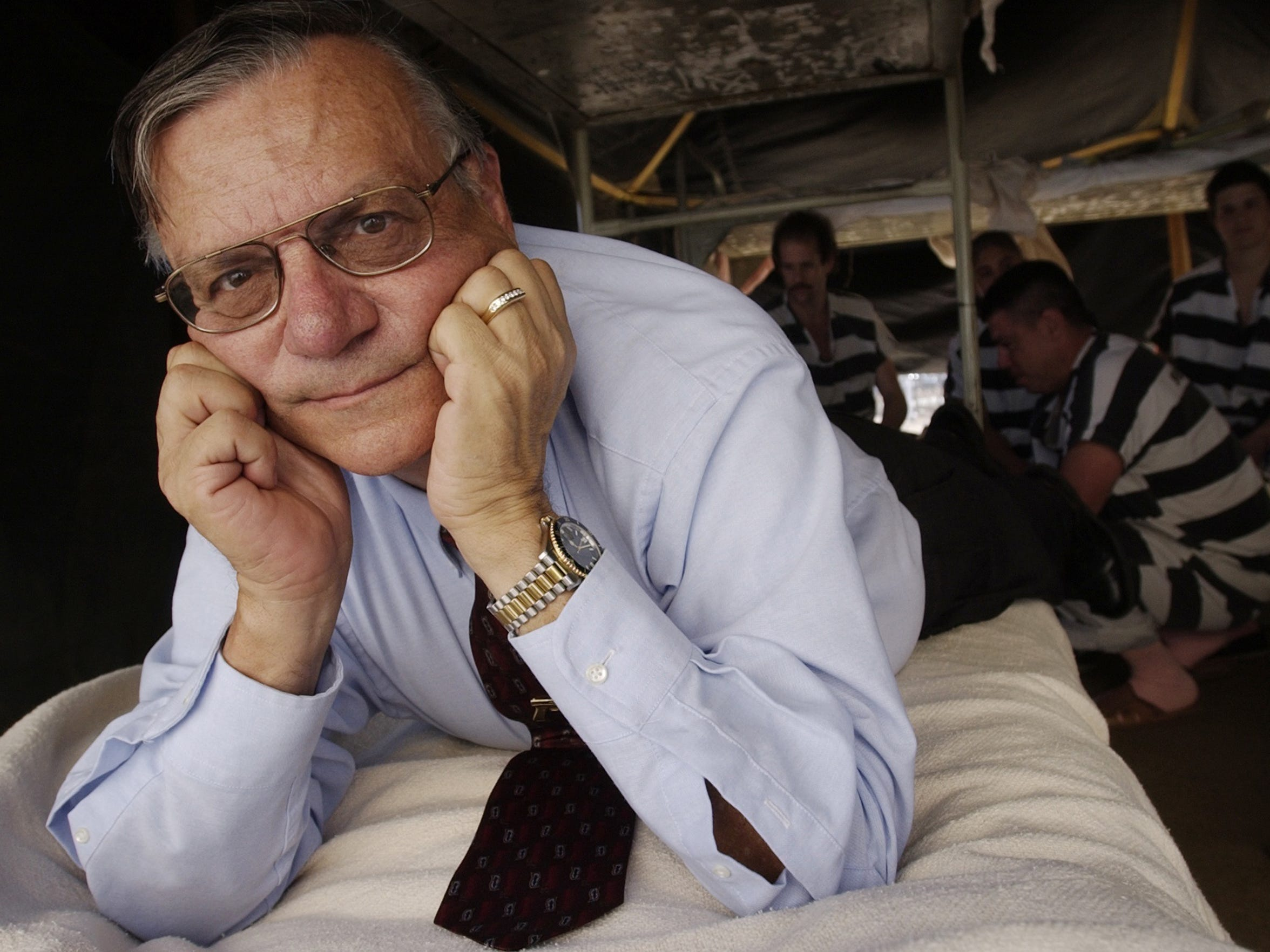 """Arpaio sprawls on a cot inside Tent City in 2002. The open-air jail has helped further his reputation as """"America's Toughest Sheriff."""""""