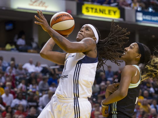 Indiana Fever's Shavonte Zellous (1) drives the ball to the basket during the first half of an WNBA game at Bankers Life Fieldhouse in Indianapolis, Sunday, September 13, 2015.