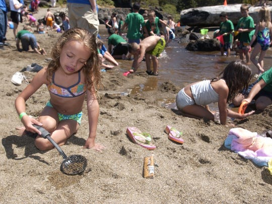 Kdasia Meyers plays in the sand by the creek at Fogarty Creek State Park. The number of people visiting the Oregon Coast jumped by 13 percent in 2015.