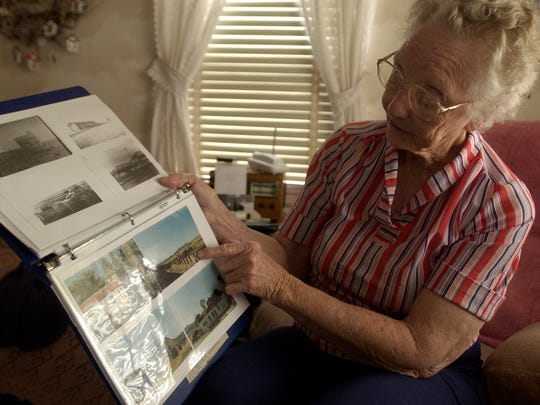 Modena resident Edna Thorley shows off some of her scrapbooks filled with the historical photographs of the town Tuesday, May 3, 2005 at her home in Modena.