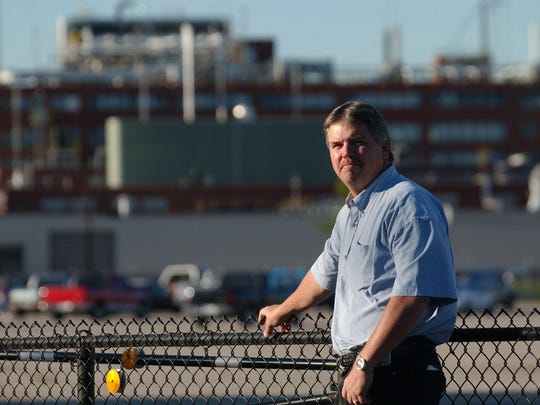 Carl Goodman, president of was then International Brotherhood of DuPont Workers, posed in front of the DuPont chemical plant in 2005.