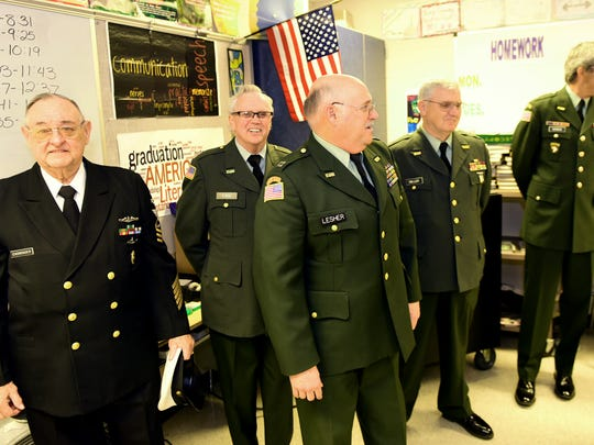 Charles Nitterhouse Veterans of Foreign Wars Post 1599 Honor Guard members Barry Ensminger, Micky Finn, Gary Lesher, Ed Miller and John Norman, were at Waynesboro Area Senior High School  on Dec. 22 to accept a donation of nearly $5,000, raised by students in Ashley Brence's 21st century communicationc class.