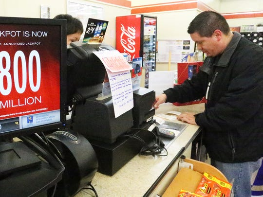 Daniel De Las Cruz of El Paso purchases 87 Powerball tickets with Power Play on Friday at the 7-Eleven store at 6200 Gateway East at Geronimo Drive. The tickets were bought for an office pool.