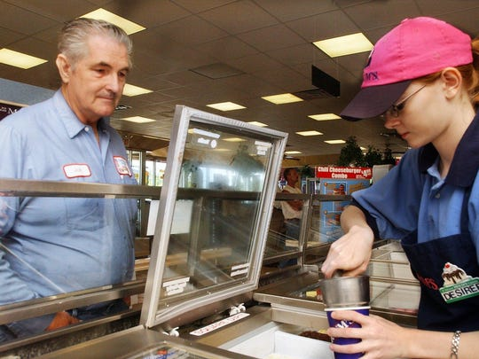 A News-Leader file photo of folks at work in a Springfield Braum's store.
