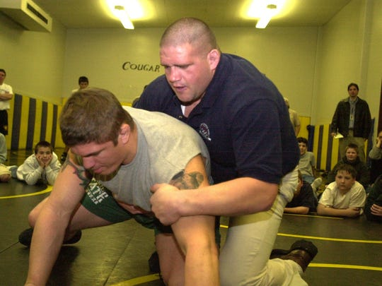 Rulon Gardner demonstrates wrestling moves on his training partner Matt Lamb Monday at Cascade High School in 2002 Gardner spoke to students in an assembly prior to the clinic.