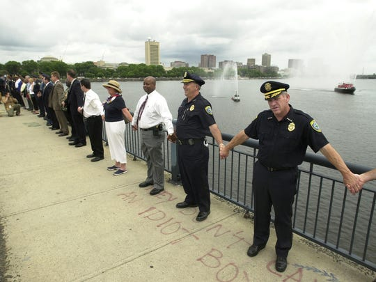 Police officers, state police and city officials meet
