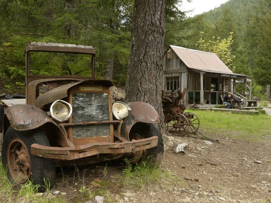 The remains of an old truck used for mining is seen as you enter Jawbones Flats, which was built in the 1930s and was an old mining town. The builiding to the right is the Company Store and across across the street is the Opal Creek Ancient Forest Center.
