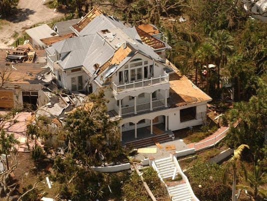 AERIAL VIEW OF DAMAGED COLLIER INN