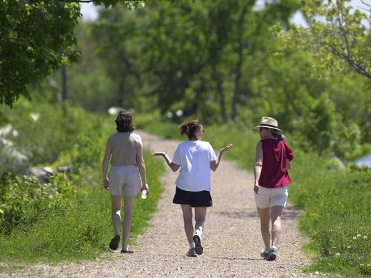 """Wendy Hallock of Shelburne (left), along with Kathleen Hill (center) and Persis Worrall, both of South Burlington, enjoy a stroll along the causeway section of the Colchester bike path Friday afternoon in June 2001. Free Press spoke to Colchester resident Lindsey Stoppacher of Dunlop Way who was worried about the path in 1999.  """"I'm not against bike paths,"""" said Stoppacher. """"I'm just against it going through this particular area."""""""