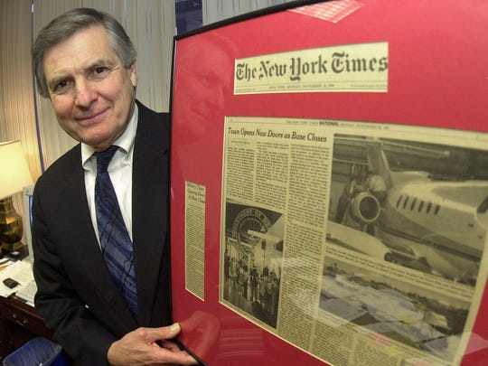 In this 2001 photo, Alexandria Mayor Ned Randolph stands with an article from The New York Times about England Airpark. Creation of the airpark from the former England Air Force Base was a highlight of Randolph's administration. Randolph, who served five terms as mayor, died Tuesday. Funeral services will be at 10 a.m. Saturday in First United Methodist Church, Alexandria.