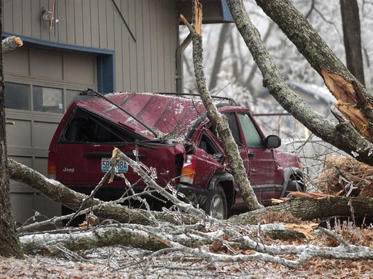 A tree heavily damaged this Jeep owned by News-Leader reporter Wes Johnson, who lived north of Springfield.