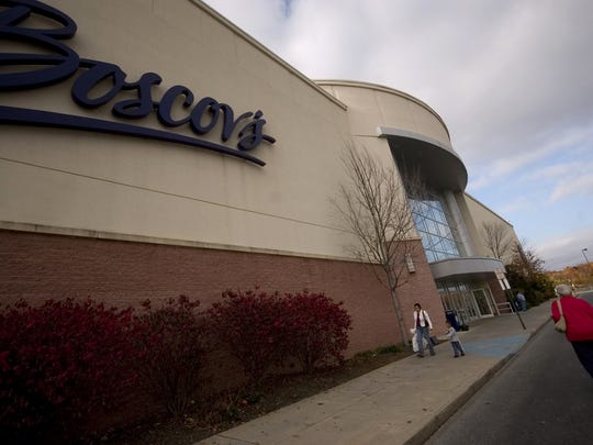 People make their way in and out of the front doors at Boscov's in Christiana in 2008.