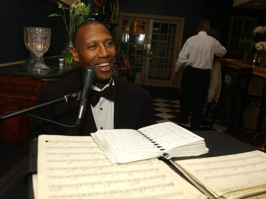 Rick Bartlett plays piano at Buck's Restaurant.