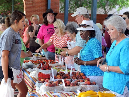 Customers peruse the peach choices during Peach Day