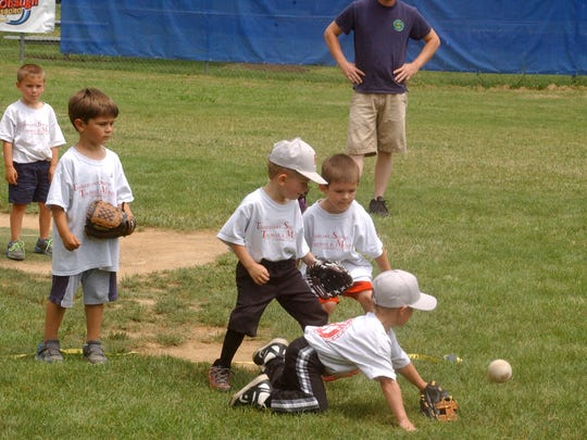 Four-year-olds scramble for the ball during a 2015 Staunton Kiwanis Blastball game at  the Kiwanis Baseball Complex in Gypsy Hill Park. Blastball is a noncompetitive sport designed for very young children to teach baseball skills.