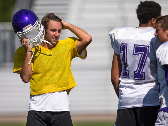 Senior Kyle Strakis, left, rests during practice at Brownsburg High School, Indianapolis, Tuesday, August 8, 2017. Strakis will start as quarterback for Brownsburg High School this fall, a position previously held by 2016-2017 Mr. Football Hunter Johnson.